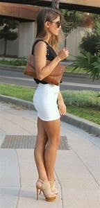 Great legs in a tight mini skirt and towering high heels ...