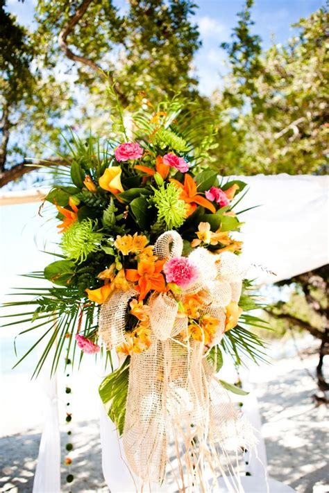 tropical beach wedding ceremony  orange  pink