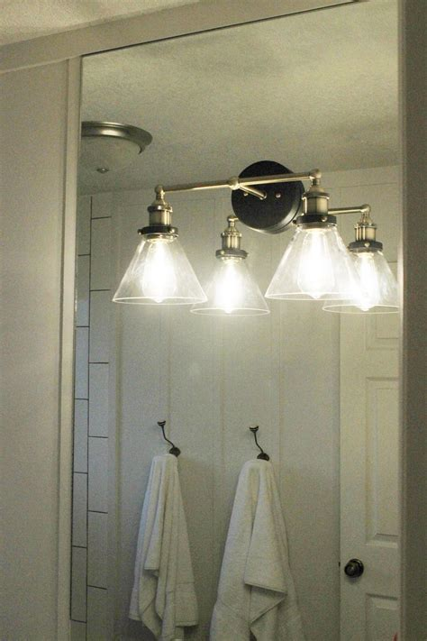how to a light on top of a mirror bathroom vanity