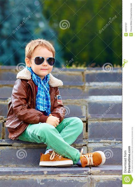 cute stylish boy  leather jacket  gum shoes stock