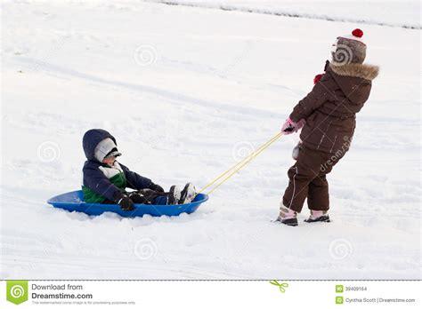 Girl Pulling Boy Children Kids Toboggan Sled Snow Stock ...