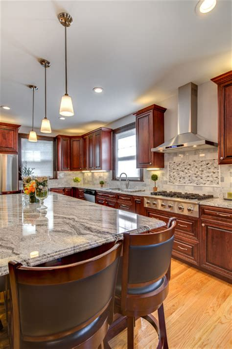 viscont white granite countertops with cherry cabinets