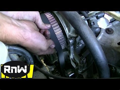how to remove and replace the timing belt and water mitsubishi 2 4l sohc engine part 3