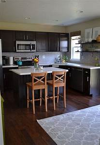 kitchen reveal dark cabinets light counters 2135