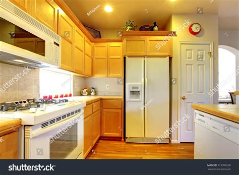 Kitchen Yellow Wood Cabinets White Appliances Stock Photo