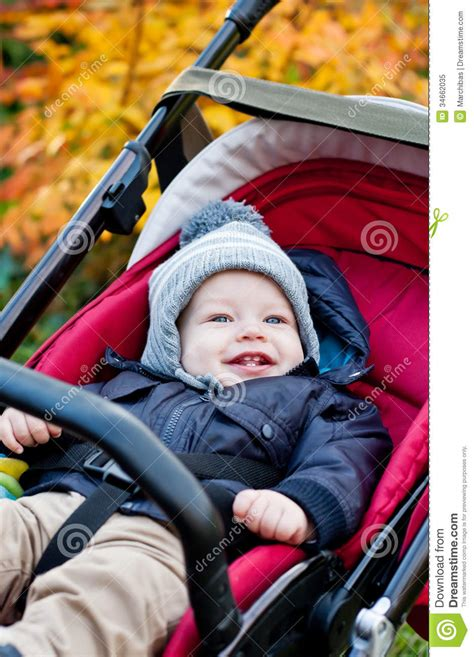 Happy Baby Boy Sitting In A Stroller Stock Image Image