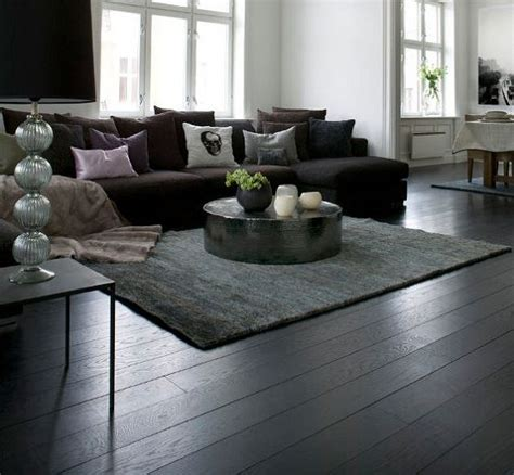 Living Room Ideas Wooden Floors by Black Wooden Flooring With Brown Sofa And Table