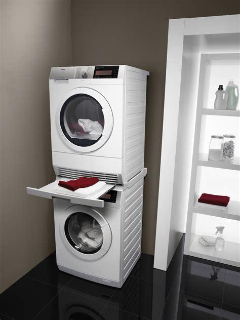trockner und waschmaschine übereinander stellen trockner auf waschmaschine befestigen verbindungsrahmen top