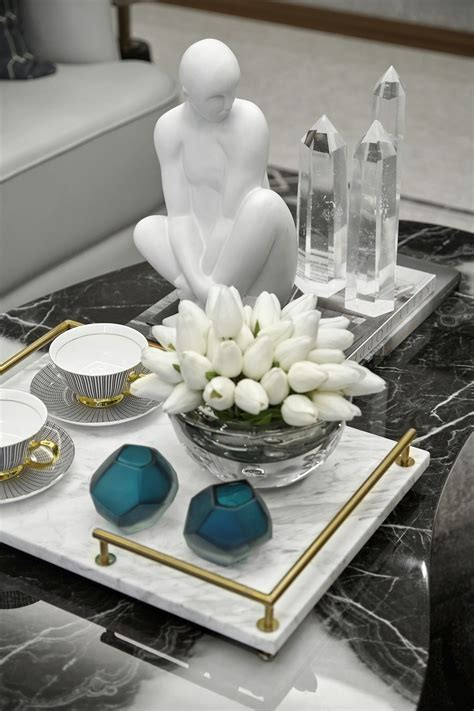 These are the quintessential feminine touches. A formal tablescape on coffee table w/ black marble top ...
