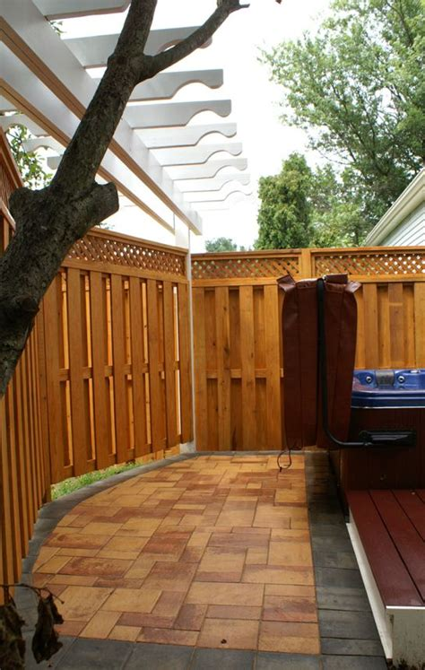 outstanding privacy fence  hot tub  redwood