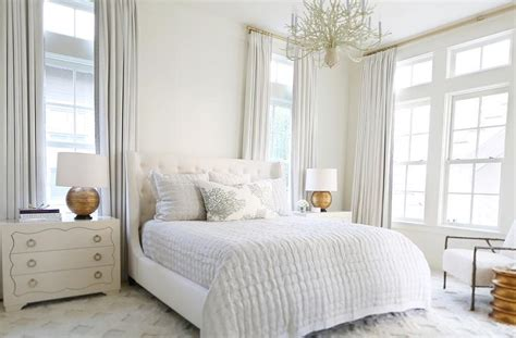 White Master Bedroom With Gold Lamps-transitional-bedroom