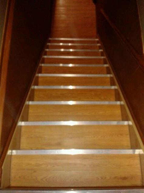faux wood vinyl tiles from lowes on basement stairs