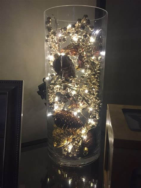 vase filled  ornaments  mini lights christmas