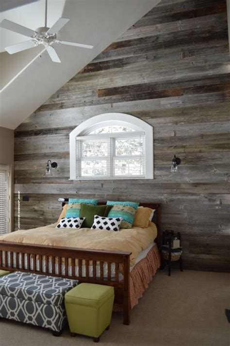 shiplap poplar accent wall bedroom rustic with dark wood bed posts chrome wall mirrors