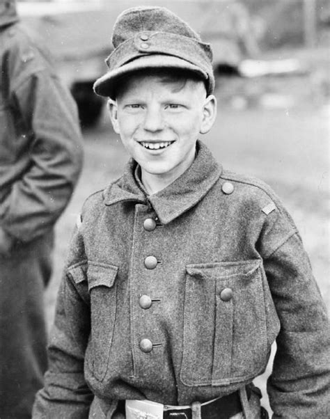 a cheerful german boy soldier captured by the 11th armored division third us army near