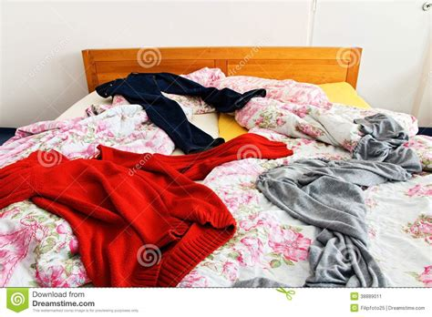 Clothes on the bed stock image. Image of comforter sleep - 38889011