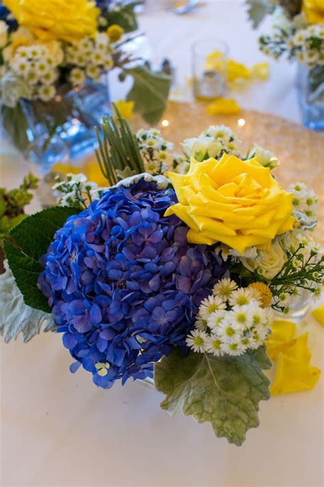 yellow rose  blue hydrangea centerpiece  white aster