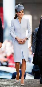 It was a pale blue coat dress with sharp shoulders (and a ...