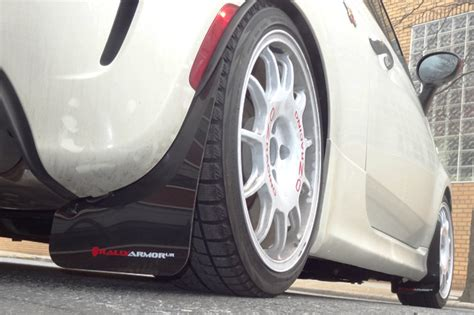 red fiat  red mud flaps white logo rally armor