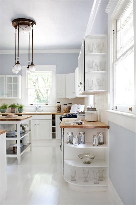 White and Bright Kitchen With End Cabinet Display Shelves