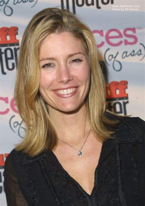Tava Smiley's simple one length hairstyle and a razor cut with hair ends flipping out