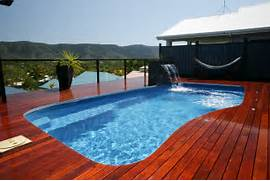 Swimming Pool Ideas With Deck Swimming Pool Designs Presenting Brown Wooden Deck And Swimming Pool