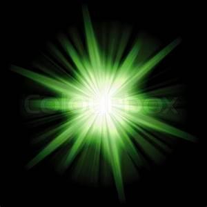 A star burst or lens flare over a black background ...