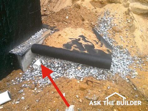 foundation waterproofing drain tile  hand  hand