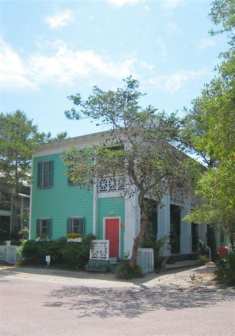 mint sea green house with coral red door happyexteriors