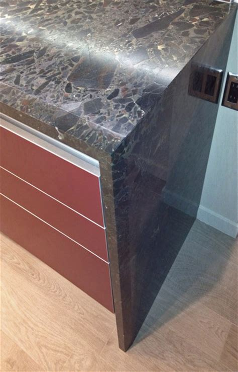 granite waterfall edge waterfall granite with custom edge detail contemporary kitchen hawaii by by design builders