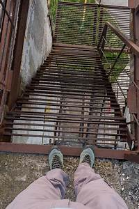 Descent, Along, The, Iron, Stairs, Human, Feet, On, The, Edge, Of, The, Stairs, Stock, Photo