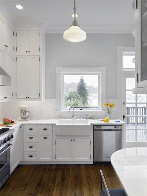 gray kitchen backsplash white kitchen and wood floors cooking spaces 1319