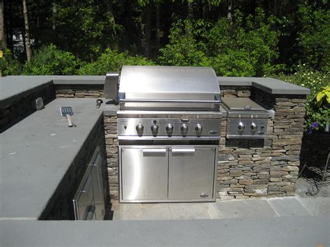 Bluestone Countertops by Outdoor Kitchen With Bluestone Countertops And Fieldstone