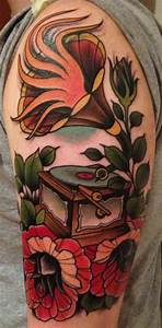 Colourful gramophone and flower tattoo - TattooMagz