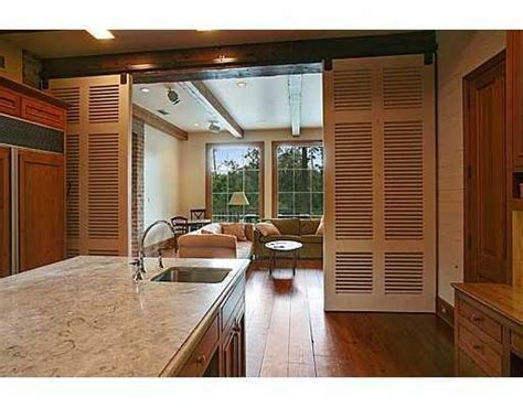 Louvered Barn Doors between Kitchen and Living Area