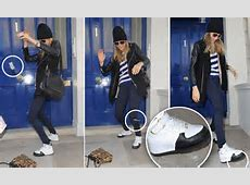 Cara Delevingne resorts to fancy footwork to try and