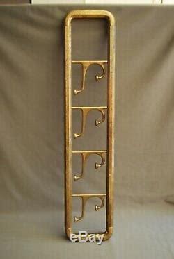 original brass wall mounted coat rack original patina