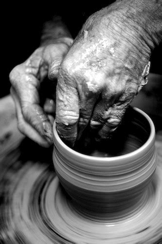 A potter's hands   Potter's wrinkled, clay covered hands