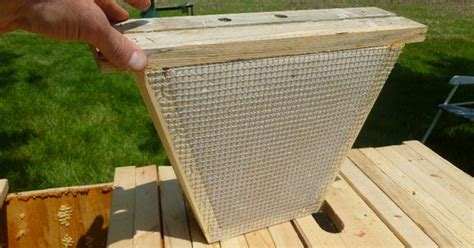 Top Bar Excluder - a board insert for a top bar hive busy bees