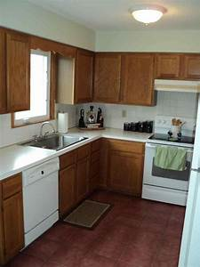 brown painted kitchen cabinets with white appliances