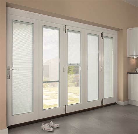 Venetian blinds are horizontal slats that allow you to control the amount of light that passes external blinds typically have loose cords that can be damaged easily and pose a hazard risk to children and pets. Exterior Interior Modern White Wooden Patio Doors With ...