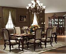 Wooden Chairs And Teak Table Under Small Traditional Dining Room Table Dining Room Ideas Freshome Lavish Dining Room Design Inspiration With Black Wooden Dining Table Dining Room Table Rustic Wood Dining Room Table Rustic Looking Dining