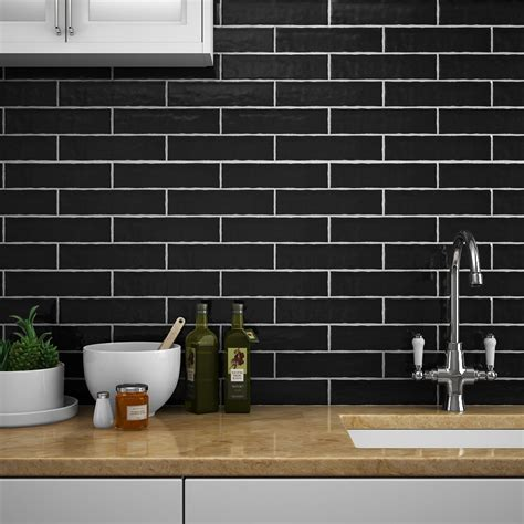 cheap kitchen wall tiles uk mileto black gloss ceramic wall tile 75 x 300mm pack of 25 8172