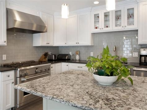 White And Gray Kitchen With Quartz And Granite Countertops
