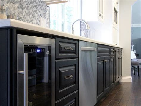 Transitional Kitchen With Black Cabinets and Wine Cooler