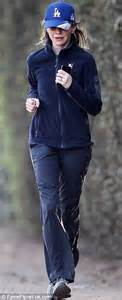 Vanessa Hudgens goes for a jog wearing pro-marijuana top ...