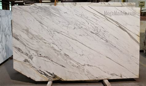 white kitchen island with granite top quartz countertops that look like calacatta marble caulk