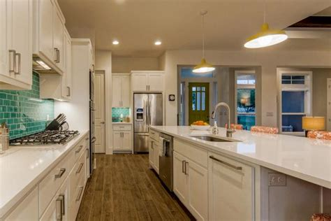 white craftsman kitchen  teal glass tile backsplash hgtv