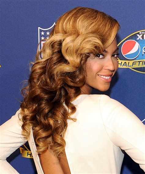 beyonce knowles formal long wavy hairstyle dark golden