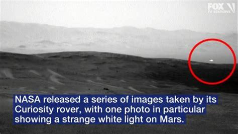 image  mysterious white light  mars captured  nasa